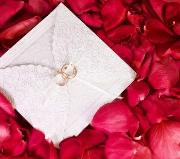 Image credit: <a href='http://www.123rf.com/photo_17960830_two-rings-on-the-wedding-card-among-the-rose-petals.html'>ninell / 123RF Stock Photo</a>