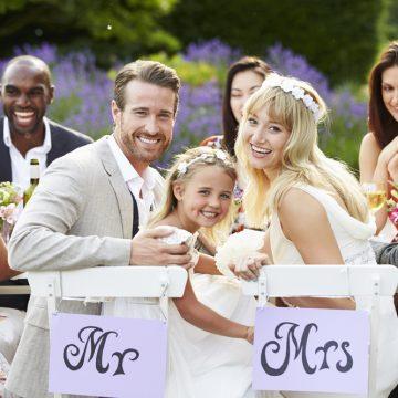Bride And Groom With Bridesmaid At Wedding Reception