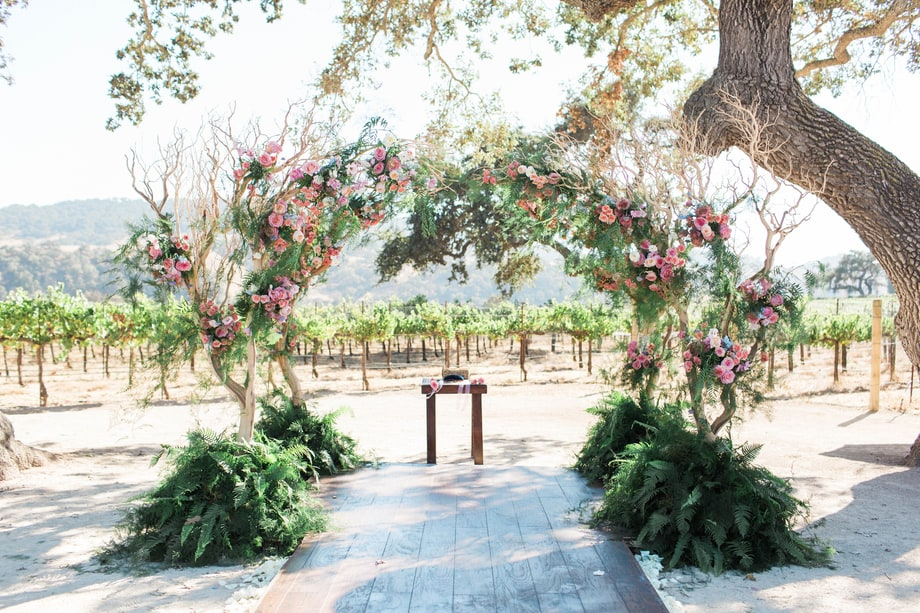 Celebrity weddings | Skyler Astin and Anna Camp's Vineyard Wedding | Floral Arbor | Outdoor Ceremony