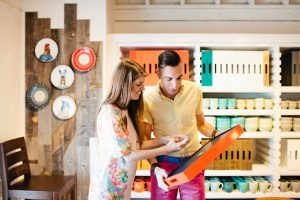 Couple at West Elm picking items for their registry