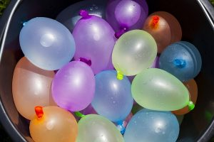 Co-Ed baby shower water balloon game