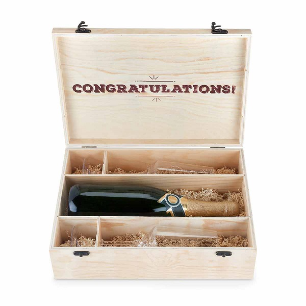 Give the newlyweds a toast they can savor with a bottle of their favorite wine or spirit.
