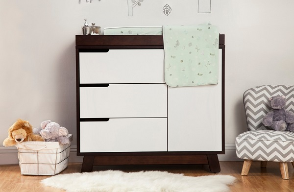 Top any dresser with a changing table and you've just opened up a world of possibilities in your small space nursery!