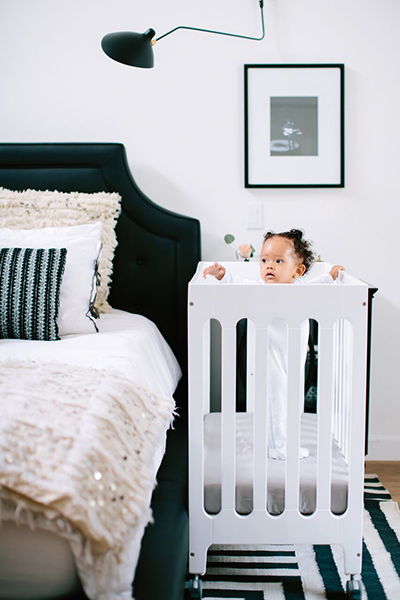 Collapsible cribs aren't just for travel—they're perfect for a small space nursery!