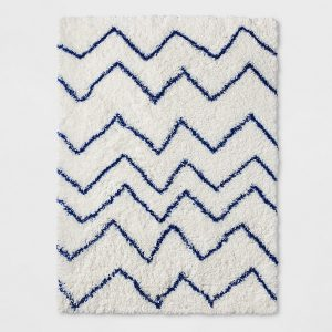 A shag rug is the quintessential go-to for a plush texture, so consider adding one to your baby's small space nursery.