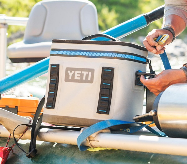 Food and drinks stay cold and safe from the elements with a sturdy Yeti cooler on board.