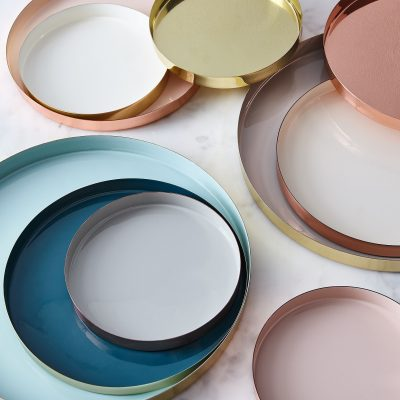 Circular brass serving trays gracefully walk the line of chic and showstopping, giving dinner guests just a hint of metallic sheen for a pop.