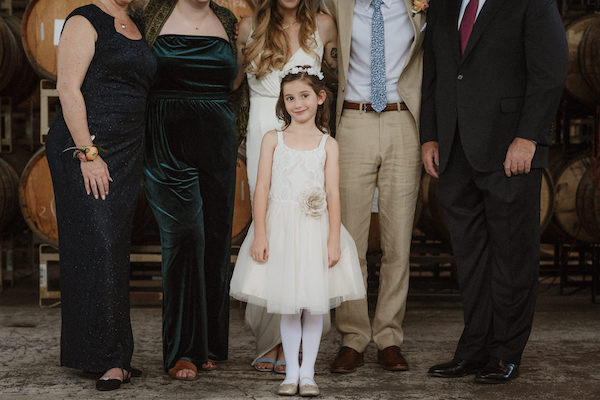 Your wish list of family photos could wind up including a few extra shots you weren't planning for—like a photobomb from your show-stealing flower girl!