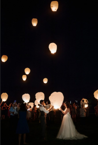 Honoring lost loved ones at wedding with a lantern send off