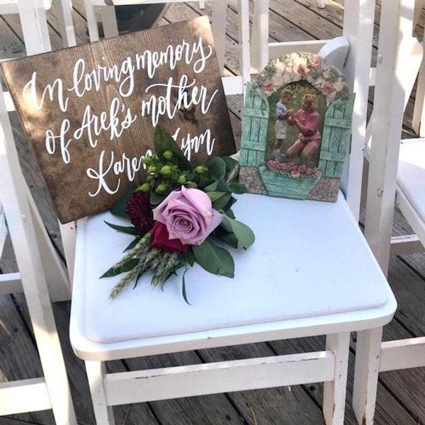 Honoring lost loved ones at wedding with a reserved seat sign