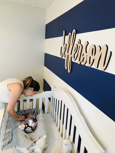 painting a striped wall in our nursery