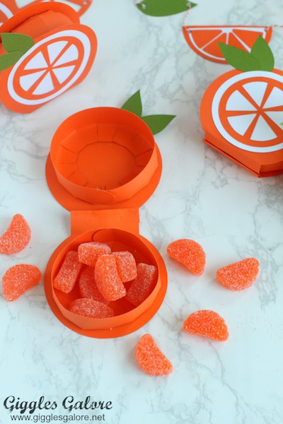 DIY boxes are filled with orange candies