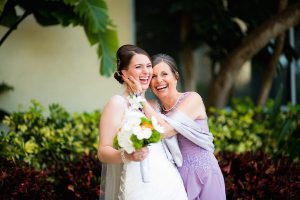 Mother Daughter Wedding Moments | Bride and her mother laughing at wedding