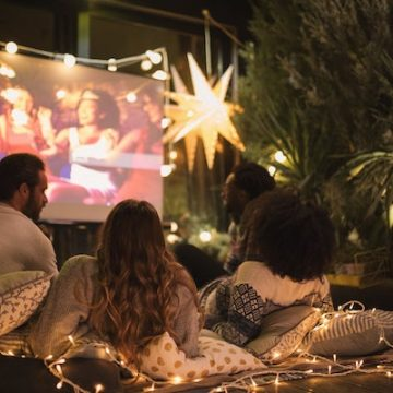 A mini projector is a high-tech way to add some vintage fun to your home movie night.