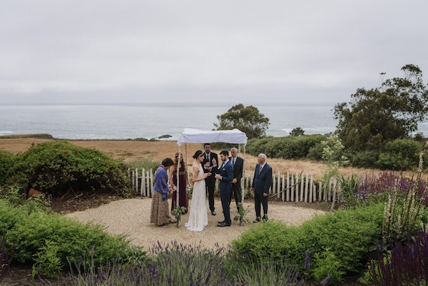 """You'll never forget sharing your """"mini"""" wedding day with a select handful of your closest friends and relatives — so go ahead, hire the photographer."""