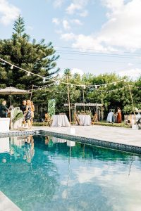 Even the most familiar, everyday location — like your future in-laws' backyard — can turn into something magical with the help of some strategically hung string lights.