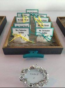 DIY wedding place cards sand dollars coastal theme