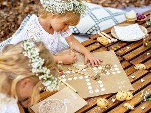 Flower girls playing games at wedding | Kids table wedding activity